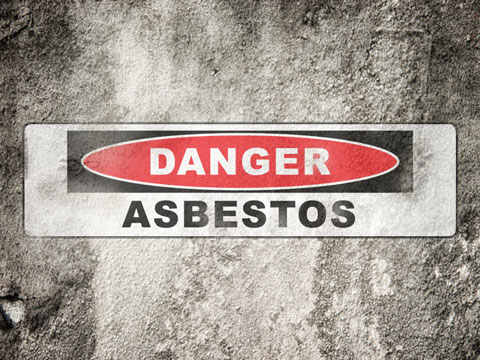 Asbestos warning on cement wall